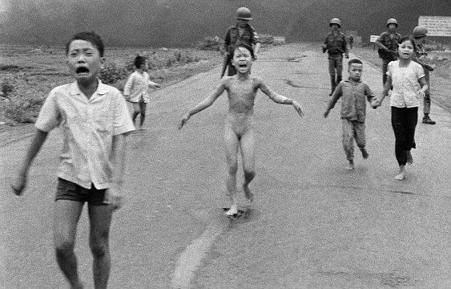 9-year-old Kim Phuc, center, flee Trang Bang following a napalm attack From left: Phan Thanh Tam, Phan Thanh Phouc, Kim Phuc, Ho Van Bon, and Ho Thi Ting. (AP Photo/Nick Ut)